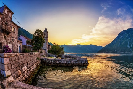 Old seaside town at sunset and mountains  Montenegro photo