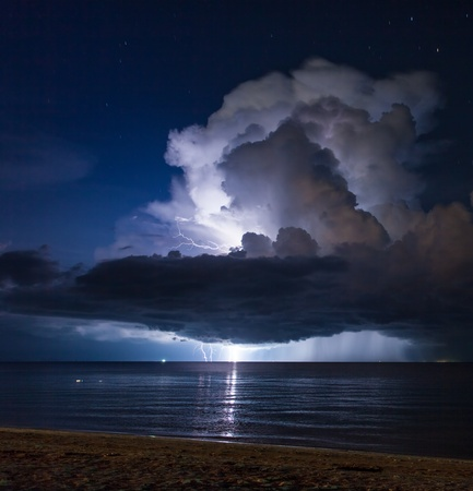 Lightning above the sea in tropical night at the beach Thailand