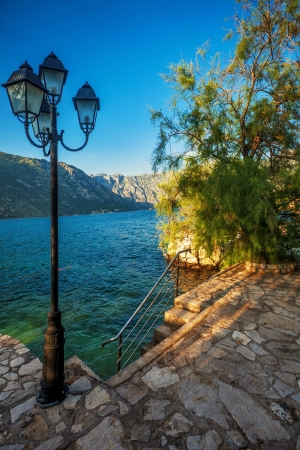 seafront with sea and mountain views in sunlights   Montenegro photo