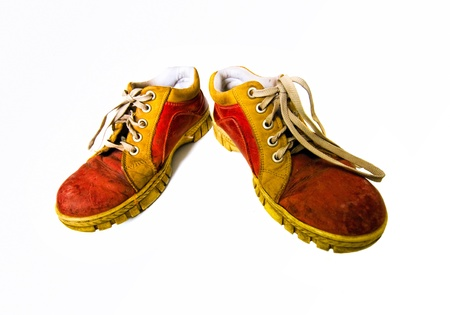 Old red dirty boots on a white background  photo