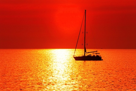 Yacht in the tropical sea at sunset  photo