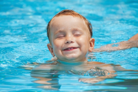 little boy in the swimming pool in hot day Stock Photo
