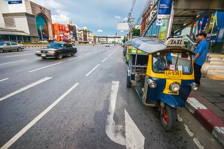BANGKOK, THAILAND - JULY 29, 2007  Traditional street taxi  tuk-tuk  awaits passengers on a street in Chinatown in Bangkok  In Bangkok, there are more than 100,000  tuk-tuk