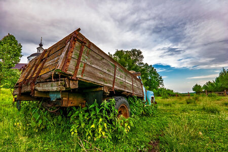 Old lorry in the field photo