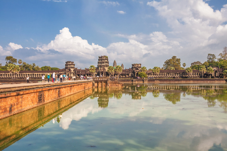 subsequently: Tourists go to the temple of Angkor Wat  Angkor Wat is a Hindu, then subsequently Buddhist temple complex and the largest religious monument in the world  Stock Photo