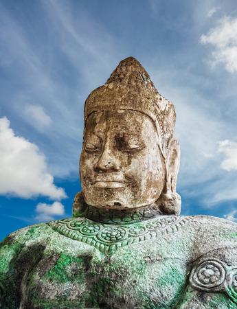 Asura statue on blue sky background, Siem Reap, Cambodia  Stock Photo