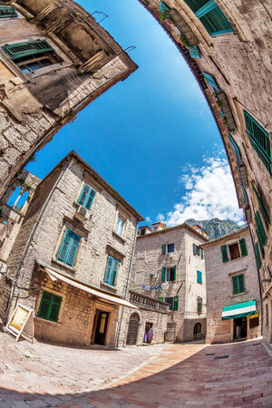 Fish-eye lens look of the old city on sky background  Kotor  Montenegro photo