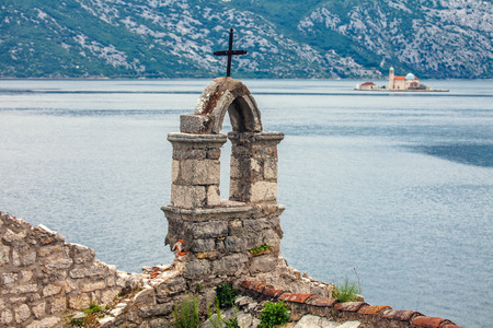 The old church overlooking the sea in bad weather  Montenegro photo