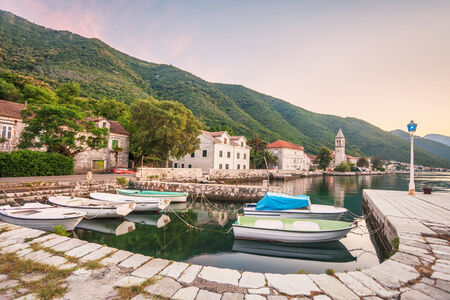 Evening in sea town on mountains background in sunset time  Montenegro photo