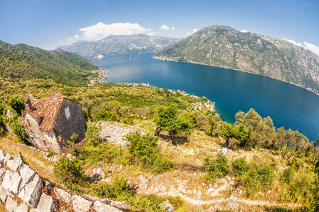 The old house with view on the sea and mountains  Montenegro  Fish eye look photo
