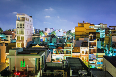 HO CHI MINH, VIETNAM - APRIL 28, 2014  Night view of one of the oldest neighborhoods in Ho Chi Minh City  Its formerly named Saigon, which was officially renamed Ho Chi Minh City July 2, 1976 Editorial