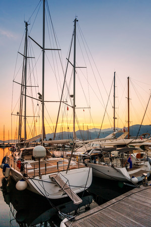 Sailing boats in marina at sunset  Tivat  Montenegro Stock Photo