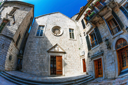 Fish-eye lens look of the old city on sky background. Kotor. Montenegro photo
