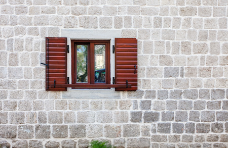 close up shot of a stone wall with window photo