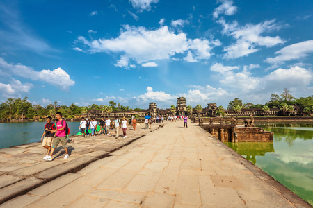 subsequently: SIEM REAP, CAMBODIA - NOVEMBER 15, 2011: Bridge to Angkor wat temple. Angkor Wat is a Hindu, then subsequently Buddhist temple complex and the largest religious monument in the world. Editorial