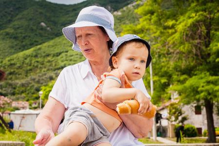grandson: Grandmother with grandson walk along the sea