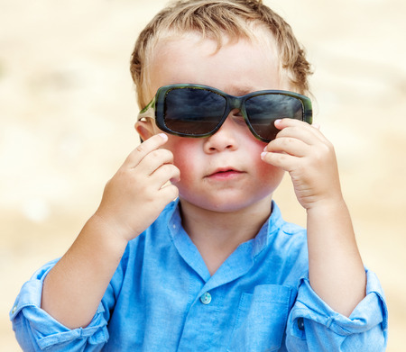 2 5: Portrait of cute 2,5 years old child with sunglasses Stock Photo