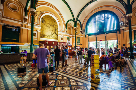 post it: HO CHI MINH, VIETNAM - APRIL 28, 2014: Customers and tourists at the General Post Office. It was built by the French in 1880s and is now a popular tourist attraction in Ho Chi Minh city