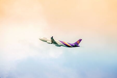 airways: PHUKET , THAILAND- OCTOBER 25, 2014: Thai Airways plane takes off from Phuket International Airport. Thai Airways - national airline was founded in 1960 and is one of the creators of the Star Alliance
