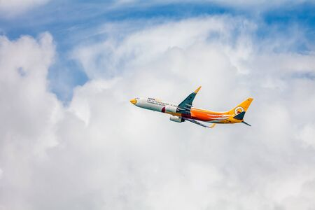 first plane: PHUKET , THAILAND- OCTOBER 25, 2014: Nok air plane takes off from Phuket International Airport. Nok Air was founded in February 2004. Nok Air has opened its first international route May 31, 2007