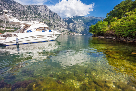 A small bay with speedboat. Kotor. Montenegro photo