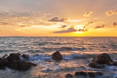 the topical: Rocks at topical beach at beautiful sunset