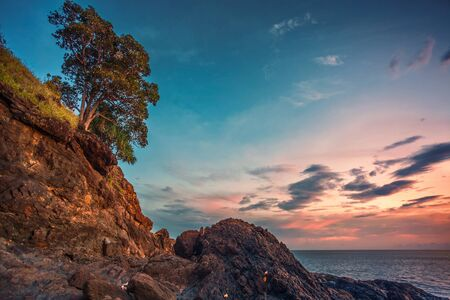 the topical: Rocks at topical beach at beautiful sunset. Nature background Stock Photo