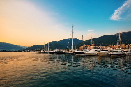 pier: Sailing boats and yachts in marina at sunset. Tivat. Montenegro Stock Photo