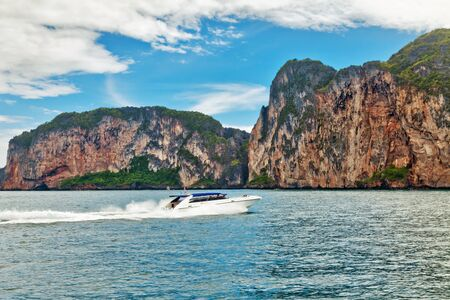 phi phi: Motor boat in motion near Phi Phi islands, Thailand Stock Photo