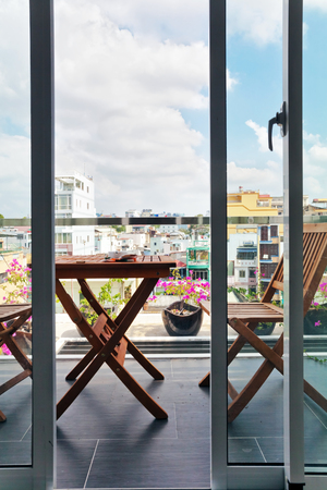 renamed: HO CHI MINH, VIETNAM - APRIL 28, 2014: View through the balcony on one of the oldest neighborhoods in Ho Chi Minh. Its formerly named Saigon, which was officially renamed Ho Chi Minh City July 2, 1976