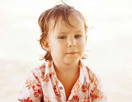 teen boy face: Portrait of child on sunny beach