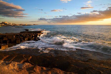 adeje: Rocks at topical beach at beautiful sunset.Costa Adeje, Tenerife, Spain Stock Photo