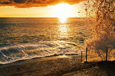 topical: Rocks at topical beach at beautiful sunset.Costa Adeje, Tenerife, Spain Stock Photo