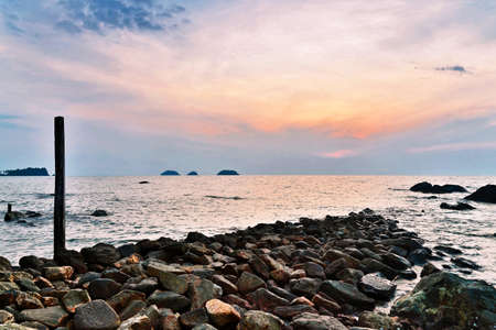 the topical: Stones topical beach at beautiful sunset. Nature background Stock Photo