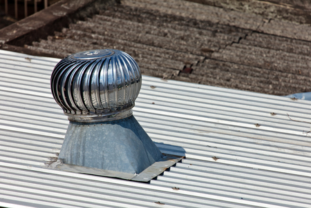 vents: Pipe of ventilation are located on a roof of a residential building