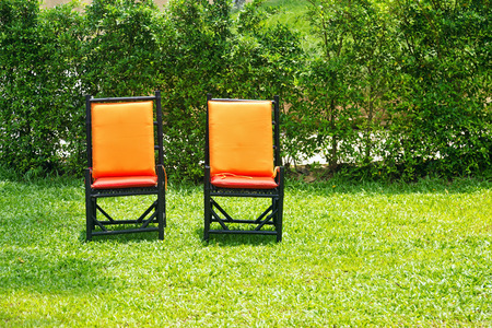 woden: Woden chairs and small table on a green lawn