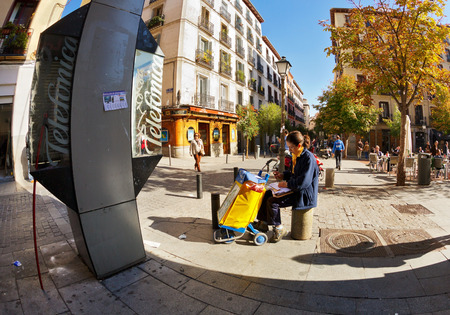 MADRID, SPAIN - NOVEMBER 11, 2015 : Postman Spanish mail Correos rests in the center of Madrid and sorts letters