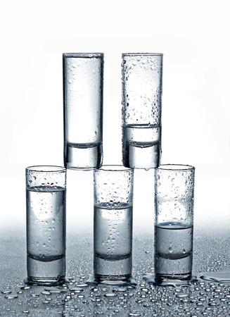 shot glasses: Shot glasses of vodka in water drops