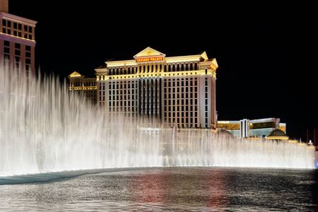 bellagio fountains: LAS VEGAS - MAY 2, 2007: The Caesars Palace Hotel is shown behind some of the fountains of the Bellagio Hotel (not shown) in Las Vegas, Nevada. Caesars opened in 1966.
