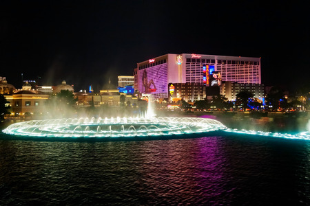 bellagio fountains: LAS VEGAS - MAY 2, 2007: Musical fountains at Bellagio Hotel & Casino. The Bellagio opened October 15, 1998, it was the most expensive hotel ever built at US$1.6 billion.