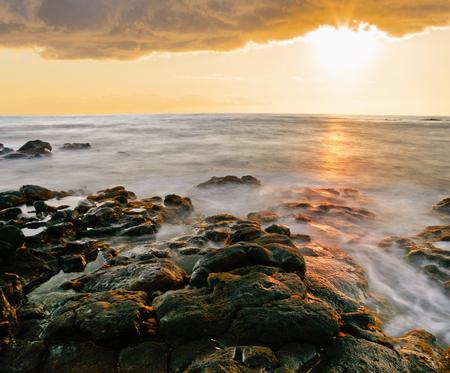 volcanic stones: Sunset at volcanic stones beach. Big island. Hawaii Stock Photo