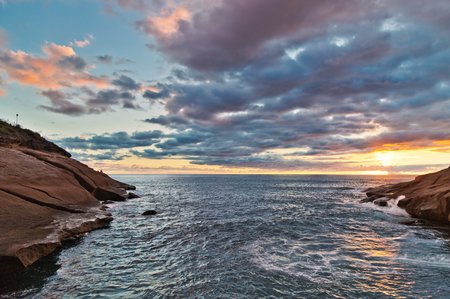 the topical: Rocks at topical beach at beautiful sunset.Costa Adeje, Tenerife, Spain Stock Photo
