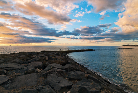 Stones at topical beach at beautiful sunset.Costa Adeje, Tenerife, Spain Stock Photo