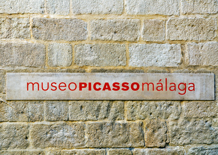 """Plate """"Picasso Museum Malaga"""" on the stone wall. Malaga. Spain"""
