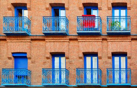brick building: Fragment of old brick building wall with windows and balconies