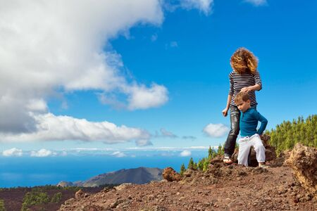 Mother and son walking at top of the mountain. Tenerife island. Spain