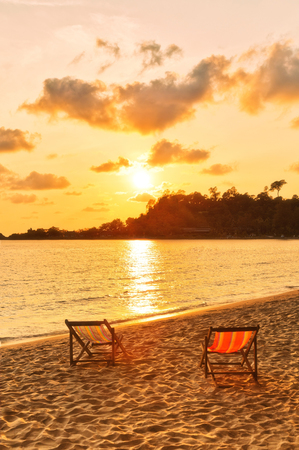 romantic beach: Beach chairs in the sand overlooking sea sunset. Thailand Stock Photo