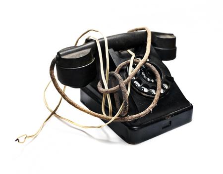 Old black phone on white background Stock Photo