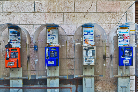 jewish community: JERUSALEM, ISRAEL - DECEMBER 29, 2016: telephones on the wall in orthodox quarter Mea Shearim, which was founded in 1874 by representatives of the religious community Zalman Baharan and Joseph Rivlin Editorial