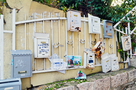 jewish home: JERUSALEM, ISRAEL - DECEMBER 29, 2016: The old mailbox on the wall in the street is typical of the old quarters of Jerusalem
